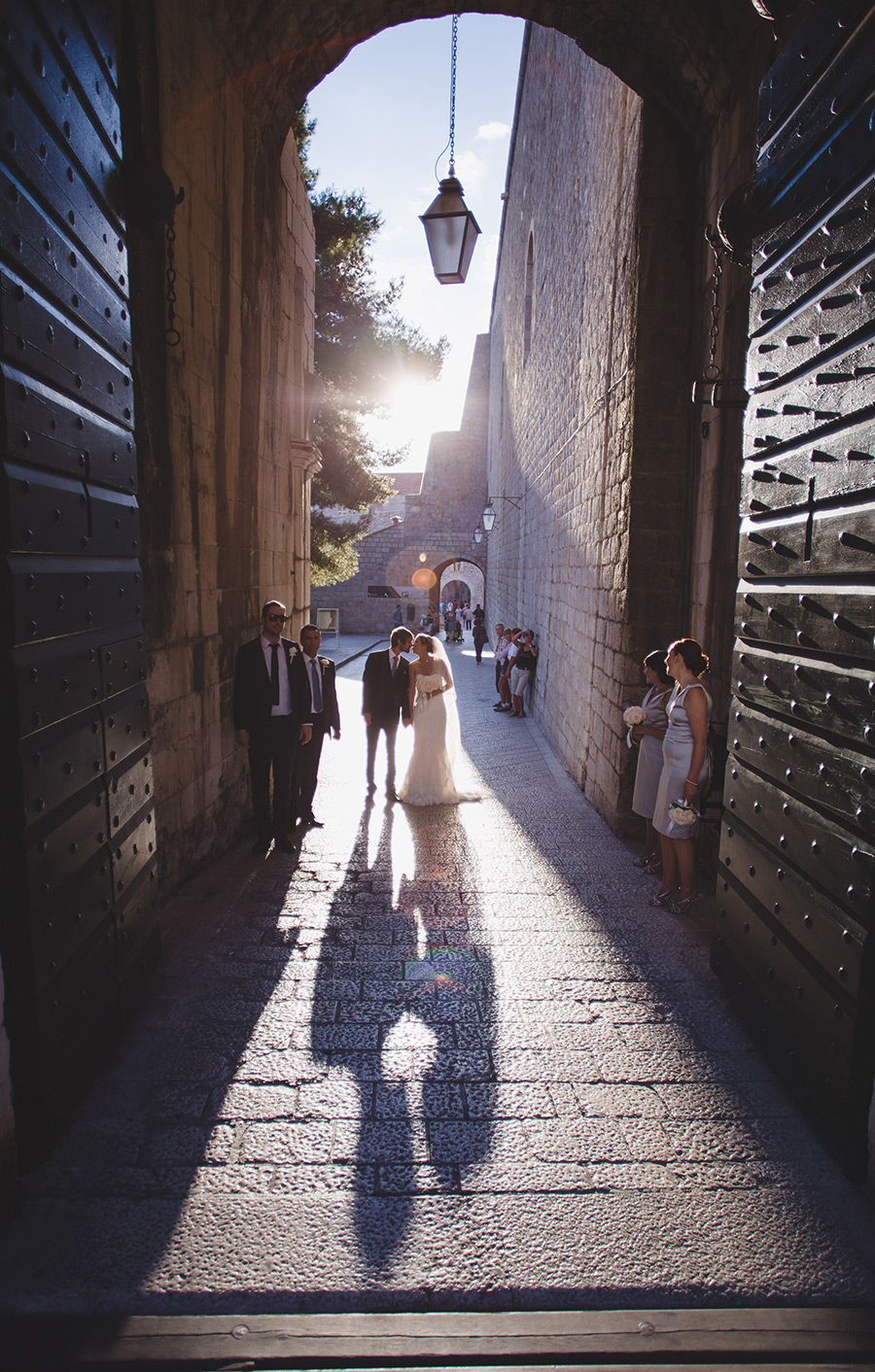 One of a set of images taken at this chic destination Wedding of Jenna & Nick. The stylish old town of Dubrovnik, Croatia.  The couple kiss in the sunset.  Photography by Matt Porteous
