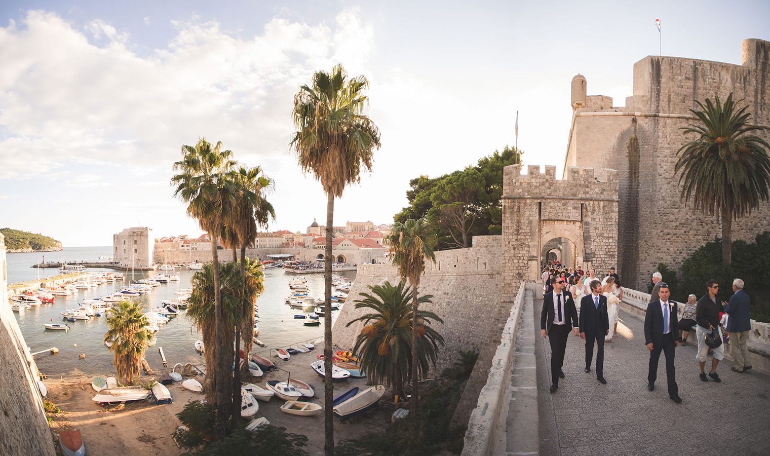 One of a set of images taken at this chic destination Wedding of Jenna & Nick. The stylish old town of Dubrovnik, Croatia.  The evening sun.  Photography by Matt Porteous