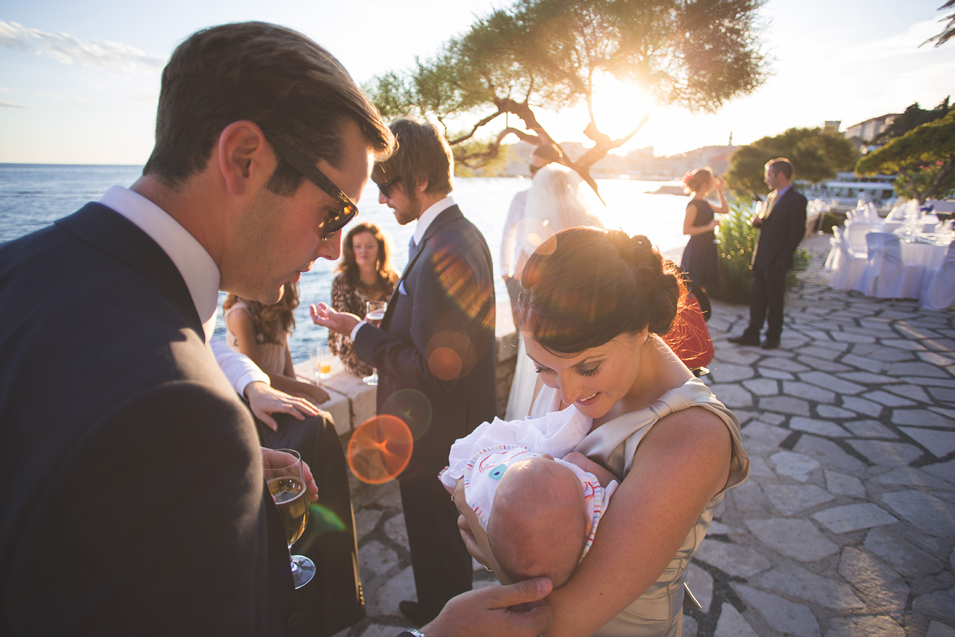 One of a set of images taken at this chic destination Wedding of Jenna & Nick. The stylish old town of Dubrovnik, Croatia.  The guests enjoy the warm evening.  Photography by Matt Porteous