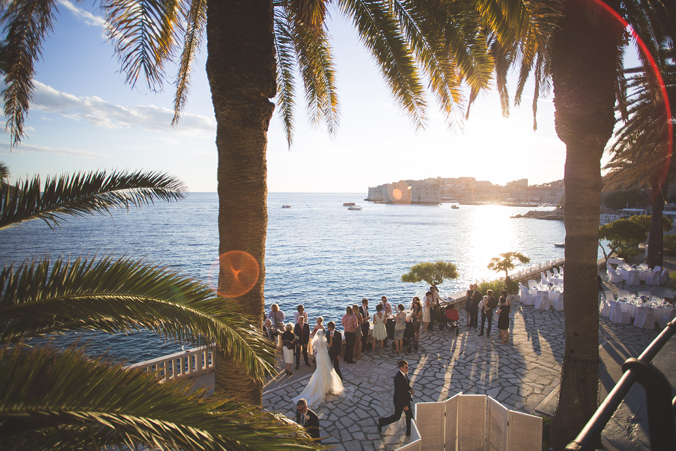 One of a set of images taken at this chic destination Wedding of Jenna & Nick. The stylish old town of Dubrovnik, Croatia. The congregation in the evening sun.  Photography by Matt Porteous