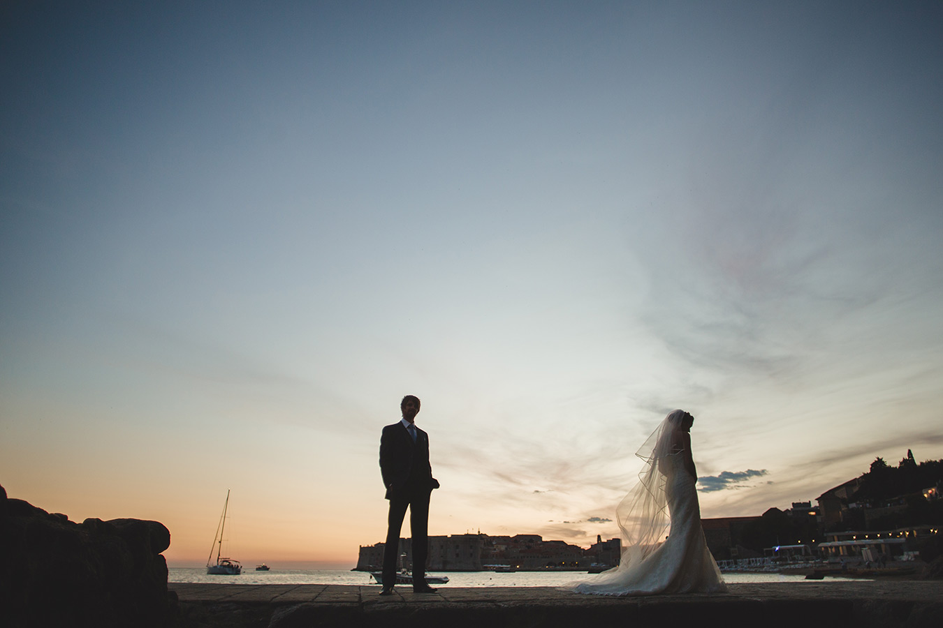 One of a set of images taken at this chic destination Wedding of Jenna & Nick. The stylish old town of Dubrovnik, Croatia.  The couple together in silhouette.  Photography by Matt Porteous