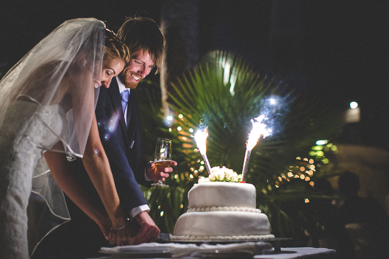 One of a set of images taken at this chic destination Wedding of Jenna & Nick. The stylish old town of Dubrovnik, Croatia.  The couple cut the cake.  Photography by Matt Porteous