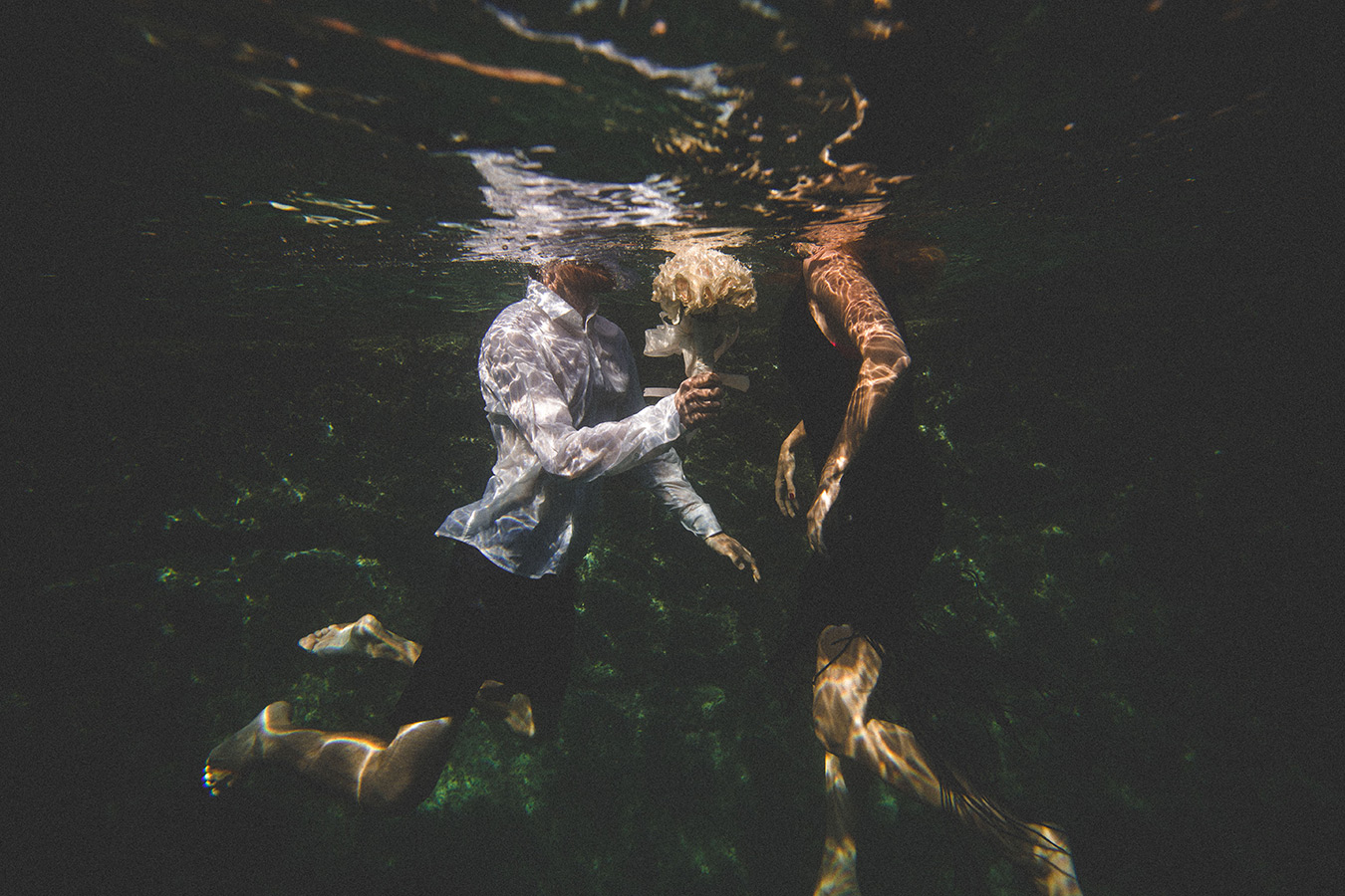 One of a set of images taken at this chic destination Wedding of Jenna & Nick. The stylish old town of Dubrovnik, Croatia.  Underwater image of the couple.  Photography by Matt Porteous