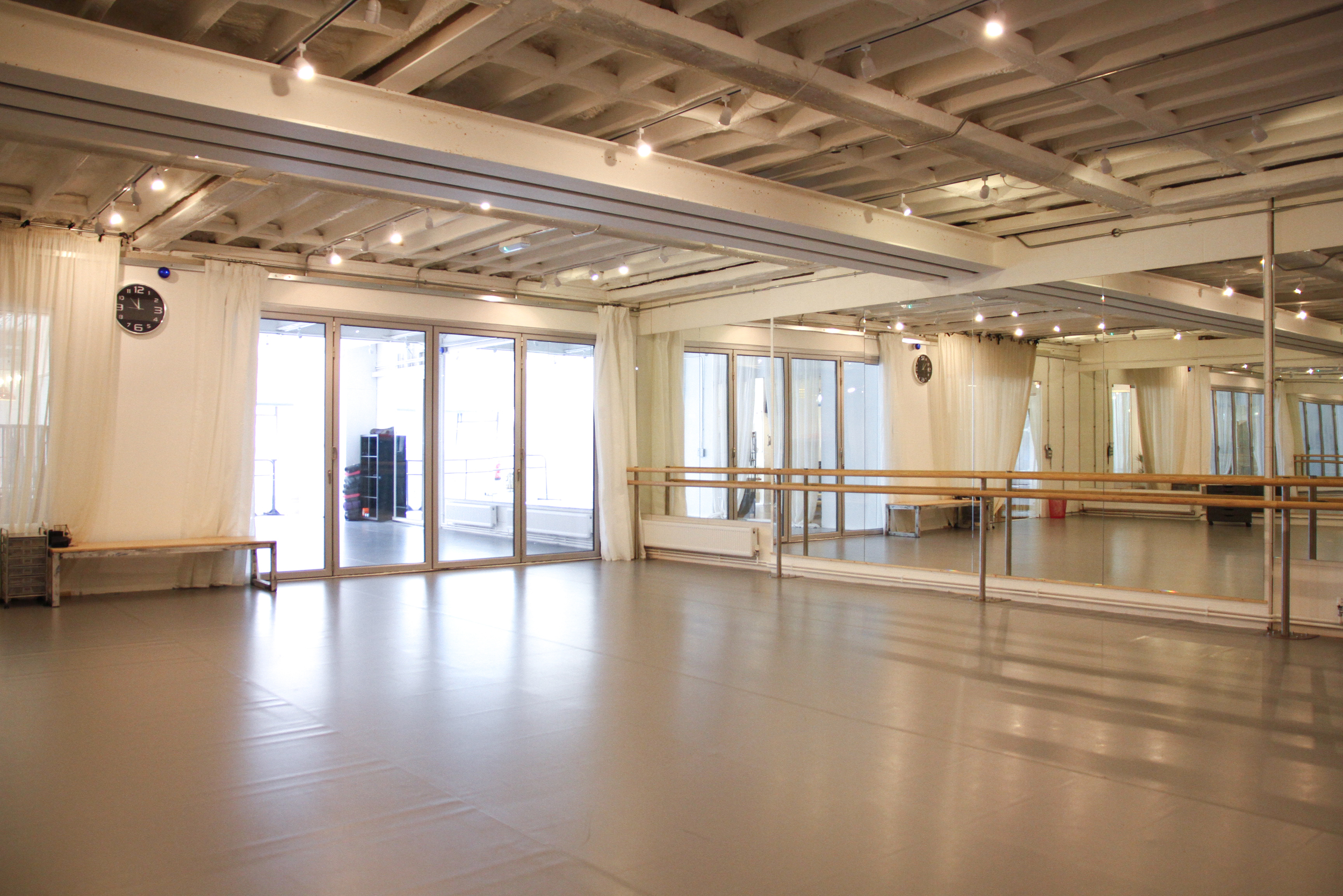 Our gorgeous Large studio looking through glass partition doors into the second studio space.