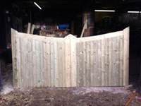 wooden light coloured fencing in workshop