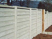 Tall fence with panels outside garden