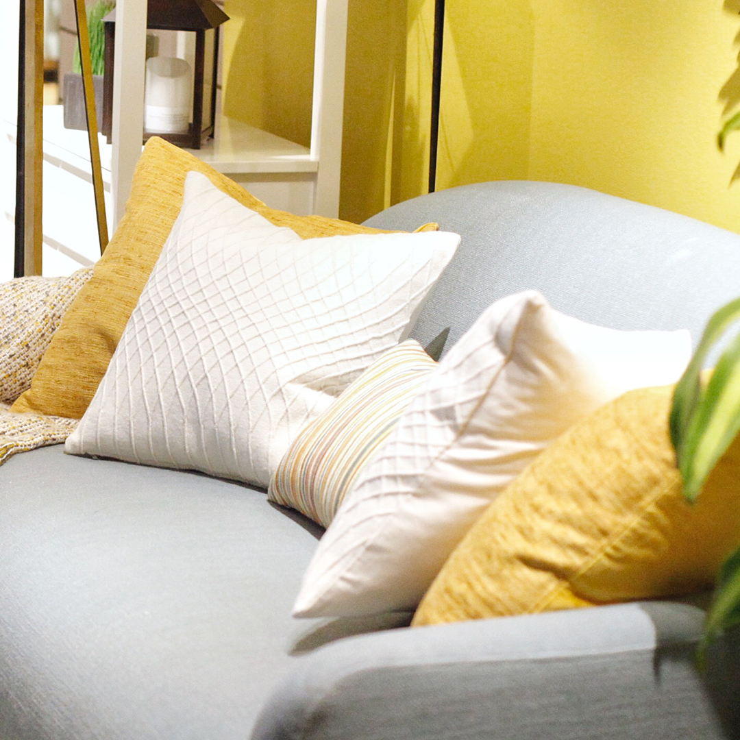Utilise accent pillows. - Pillows provide an instant lift to an otherwise ordinary looking sofa. Simply highlight your sitting area with a bold patterned pillow as the key piece and complement it with several neutral-toned pillows for a setting well put together.