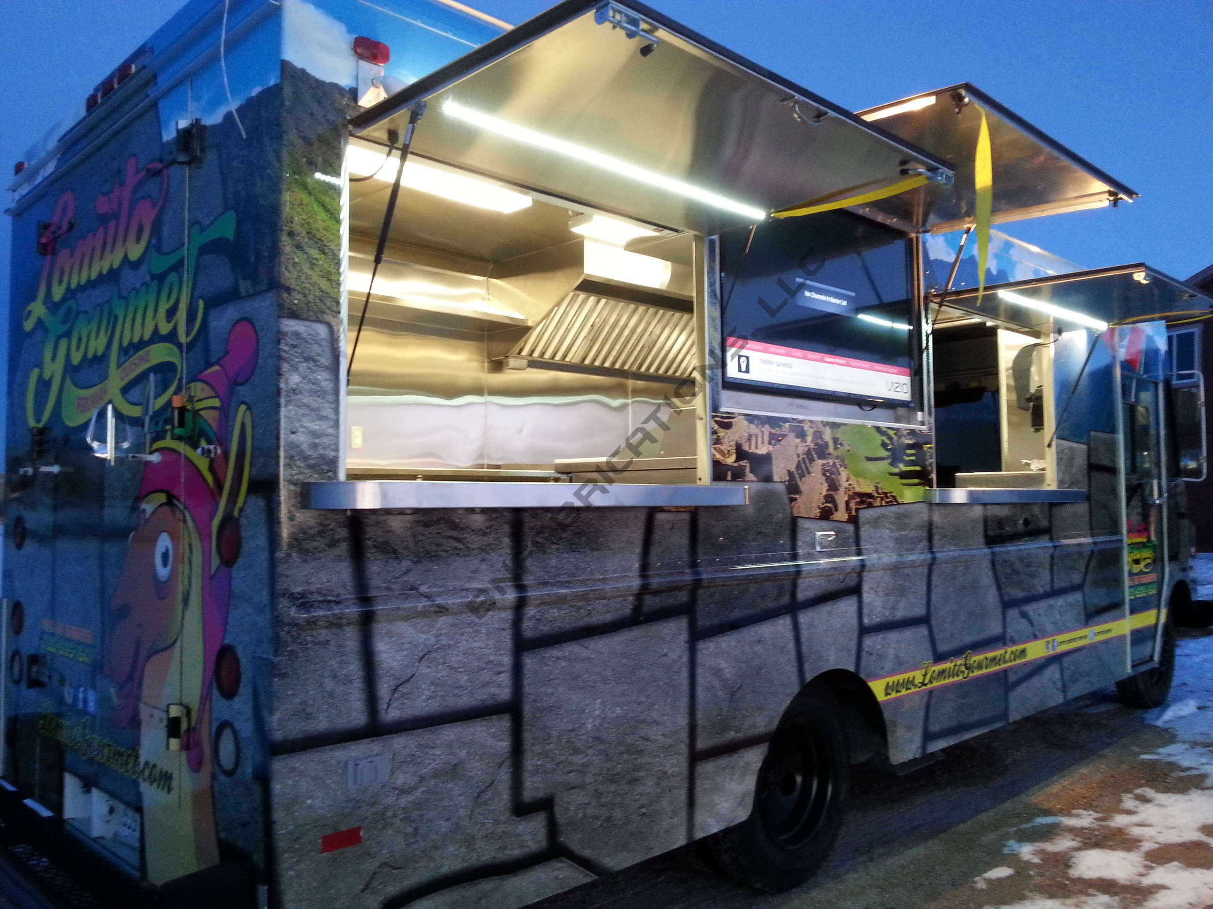 Lomito's food truck serving window and TV awnings