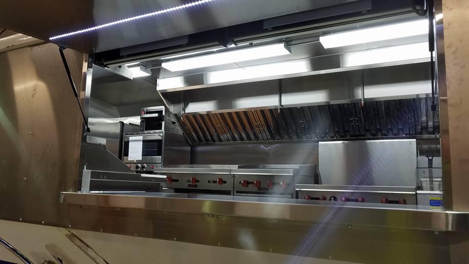 Custom serving window awnings on food trucks