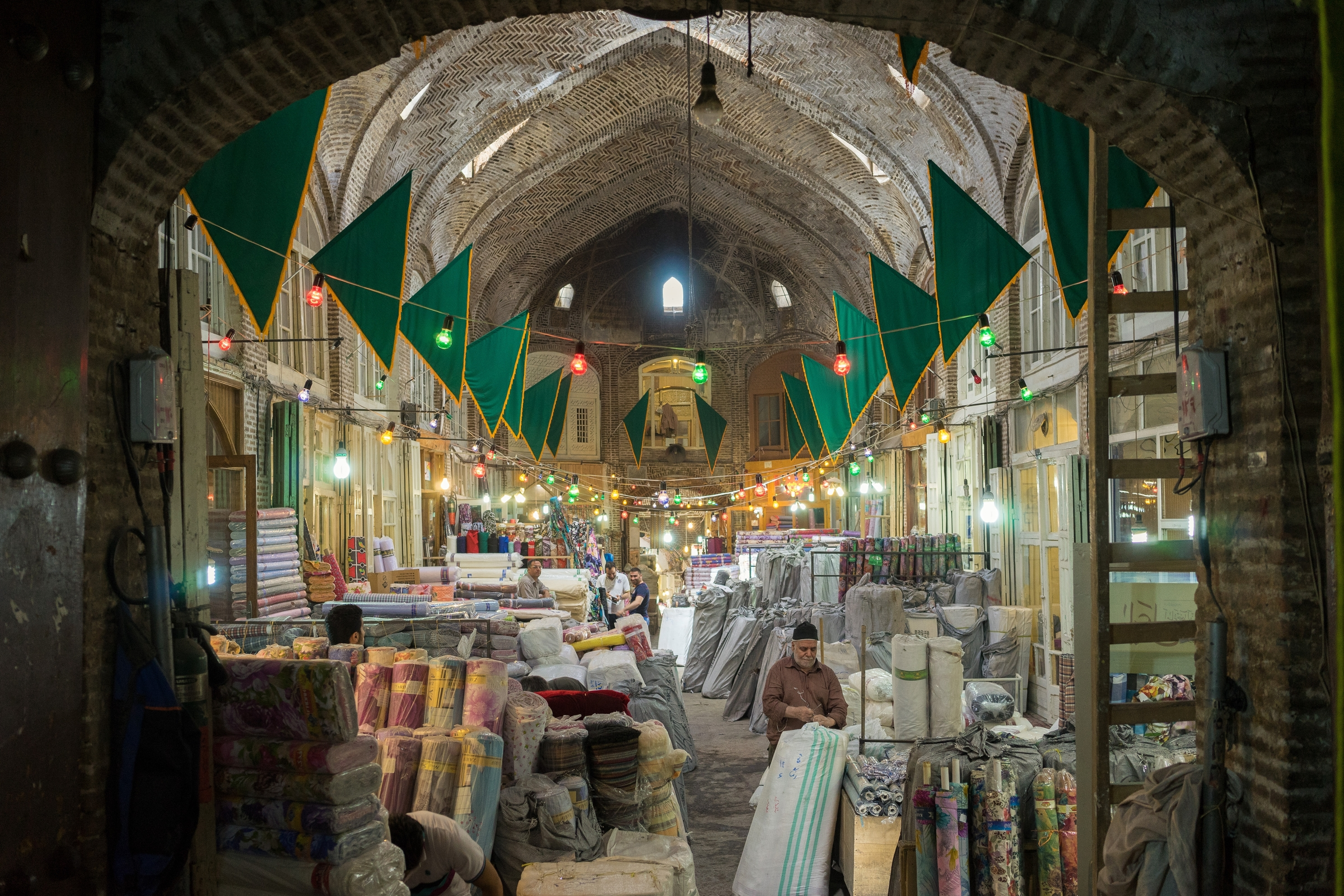 A view of the traditional Iranian bazaar where may Iranians still choose to shop each week. The unique shopping experience in the bazaar, underpinned by personal relationships between the shopkeeper and the consumer, is threatened by the growing popularity of Western-style malls.