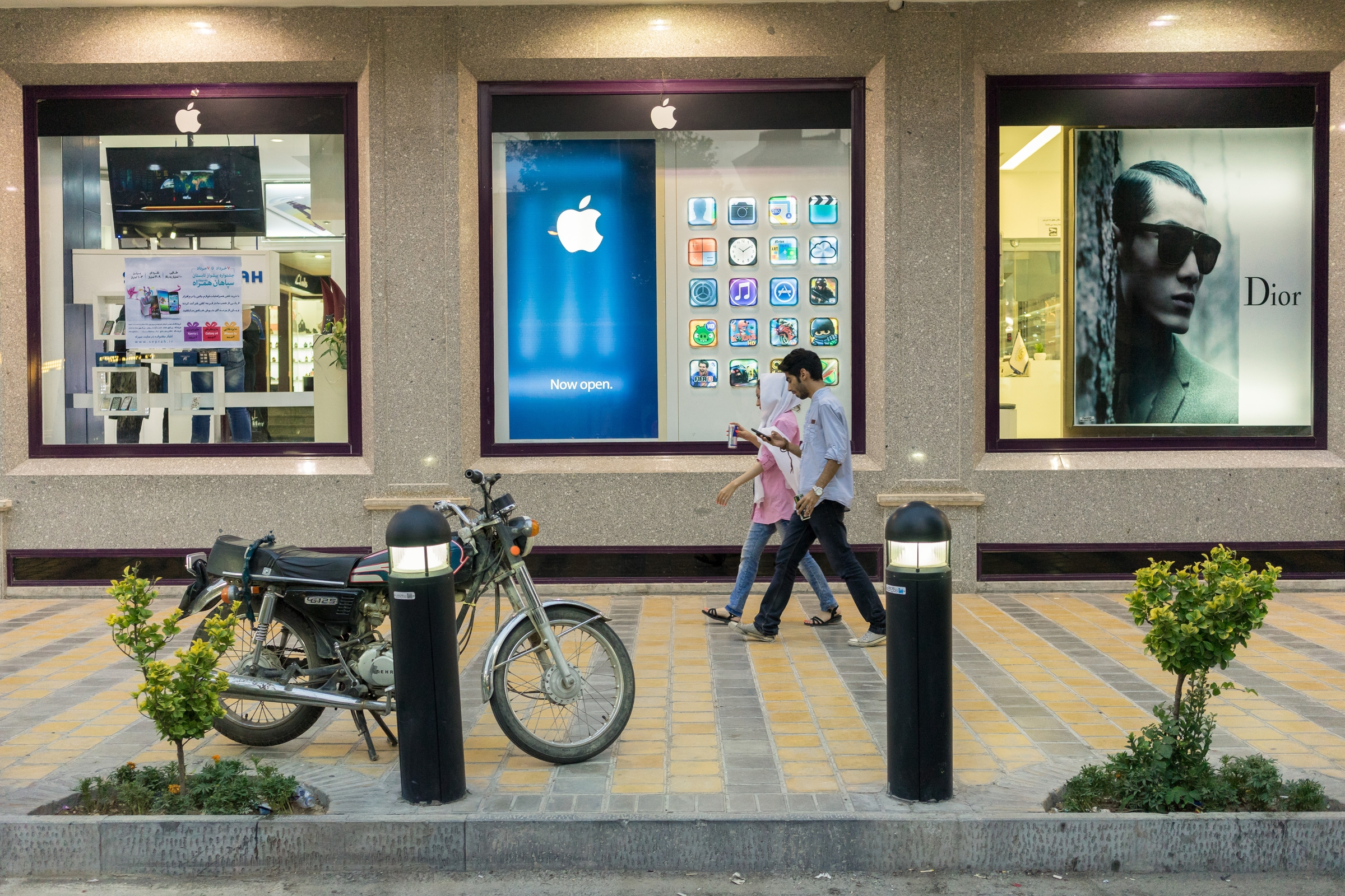 "Unofficial Apple retailers are ubiquitous in Tehran, and the popularity of the iPhone in the country has fueled rumors that Apple is seeking to enter Iran officially through a local agent. At the moment, Apple branded products, like many luxury goods, enter Iran as ""grey-market"" imports."