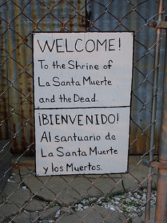 """Santa Muerte 20100601 002"" by Jim Hobbs. Via  Flickr . A ""backyard shrine"" to Santa Muerte in the photographer's neighbourhood"