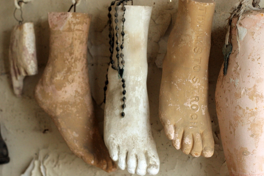 gwen - 'St. Roch's, various plaster feet'. Via  Flickr . License:  CC BY-NC-ND 2.0 .  Plaster feet hung on a wall, left as devotional offerings by supplicants in search of miraculous cures, in the St Roch (d. 1327) chapel and shrine in New Orleans (Louisiana, USA).