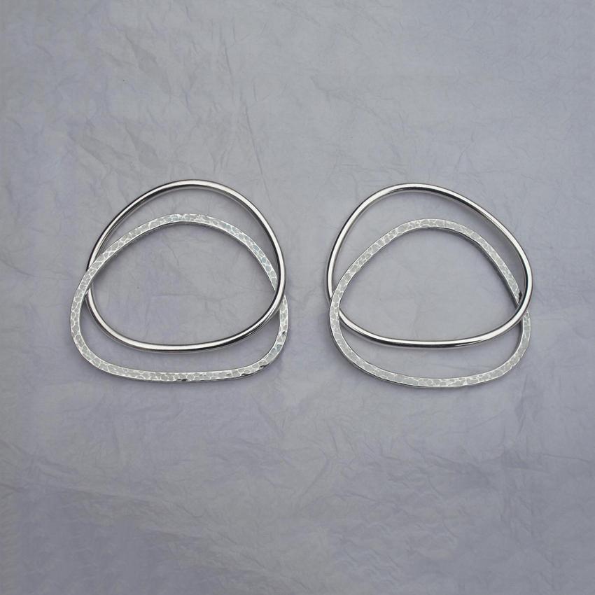 Four silver bangles.jpg