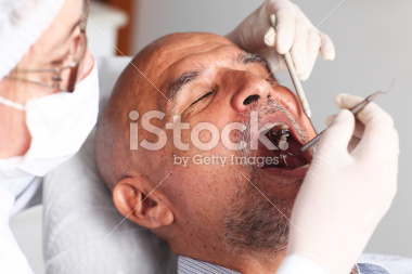 stock-photo-19601160-man-at-the-dentist.jpg