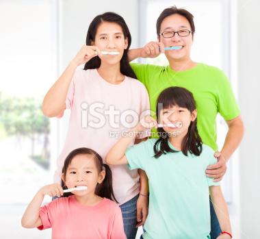 stock-photo-27882768-happy-family-brushing-their-teeth.jpg