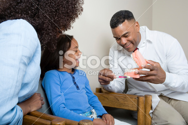 stock-photo-57256186-dentist-showing-patient-how-to-clean-teeth.jpg