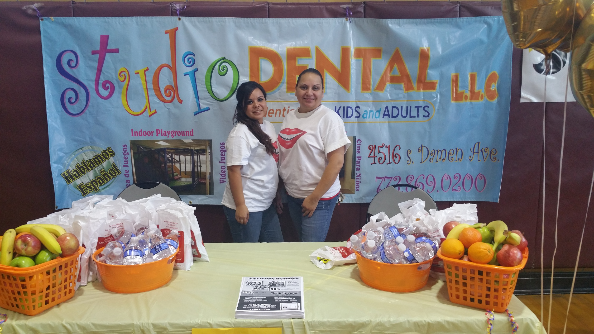 Studio Dental staff behind their table at the Back to School Health and Fun Fair at Davis Square Park