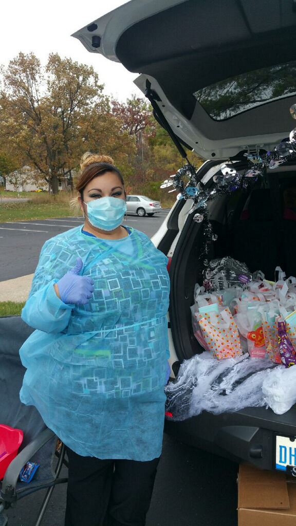 Kalamazo Dental Dreams office dressing up and passing out goodie bags for Trunk or Treat