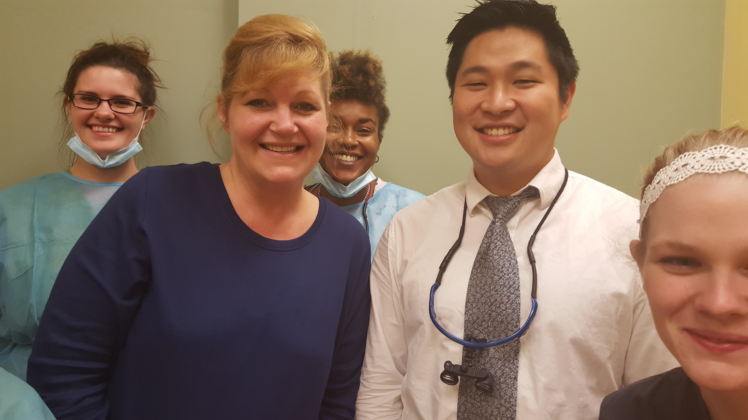 Tracy Evans showing off her pearly whites with Dr. Joshua Kim and Harrisburg Team