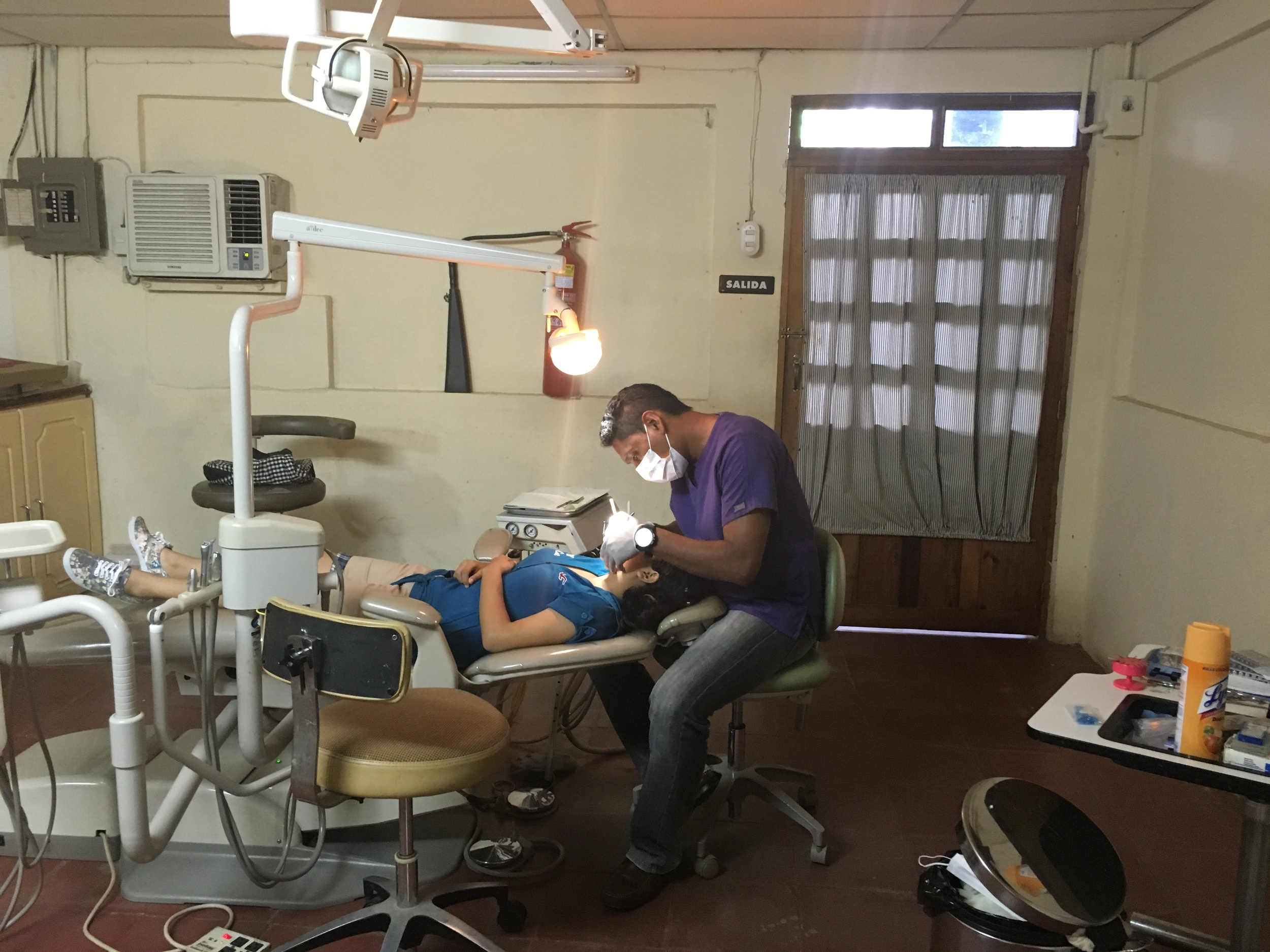 Oscar Gonzalez providing dental care in Nicaragua