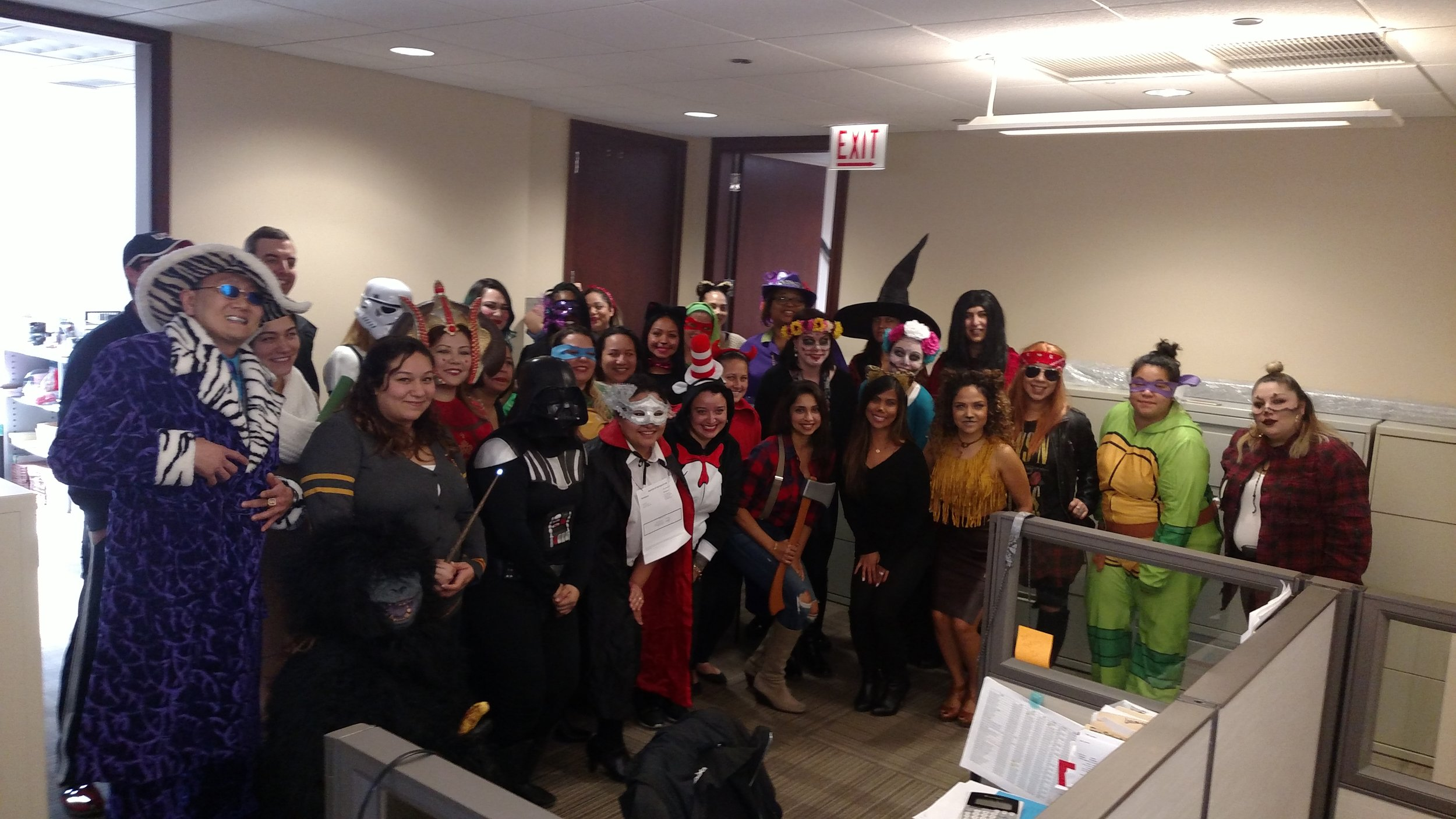 Dental Dreams home office employees in costume for halloween.