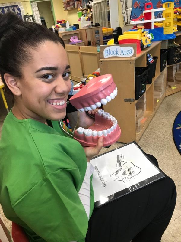 Dental Dreams staff showing proper teeth cleaning