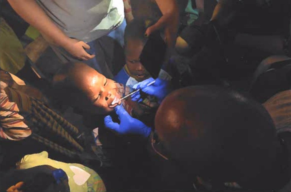 Dental staff showing proper dental care to patients in Haiti