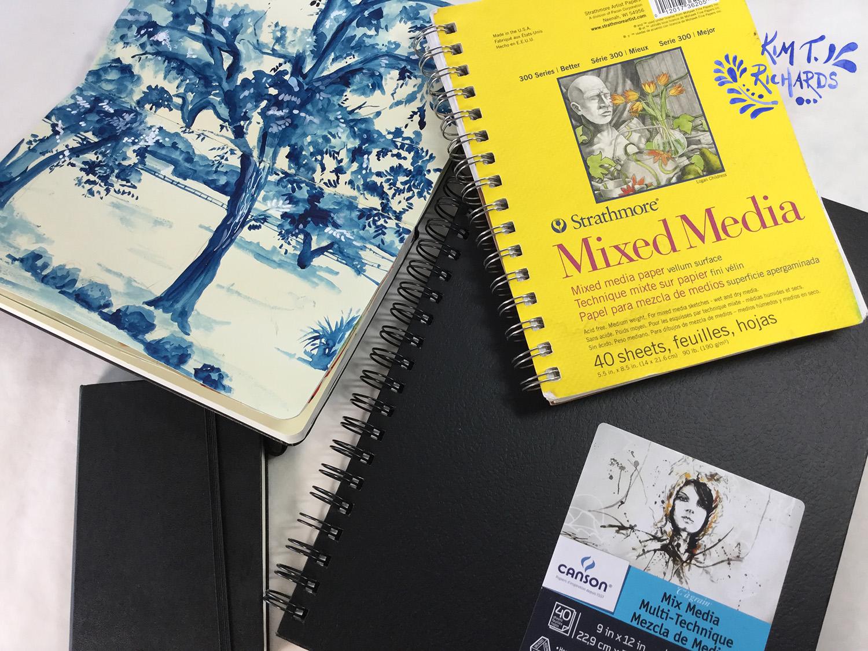 A few of my many sketchbooks.