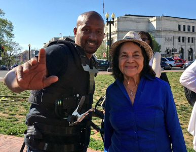 Crew member Tim Wilson with Dolores Huerta, co-founder of United Farm Workers.