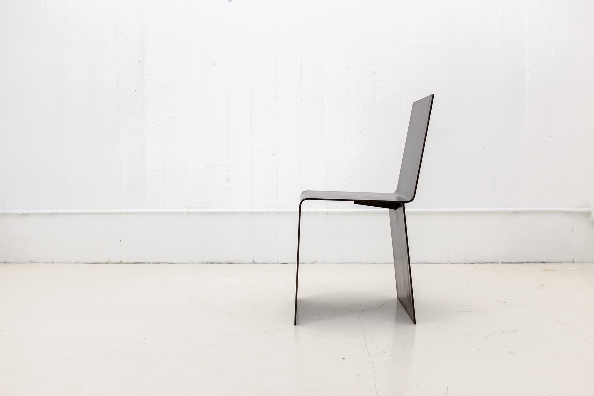 Bent Patinated Steel Chair