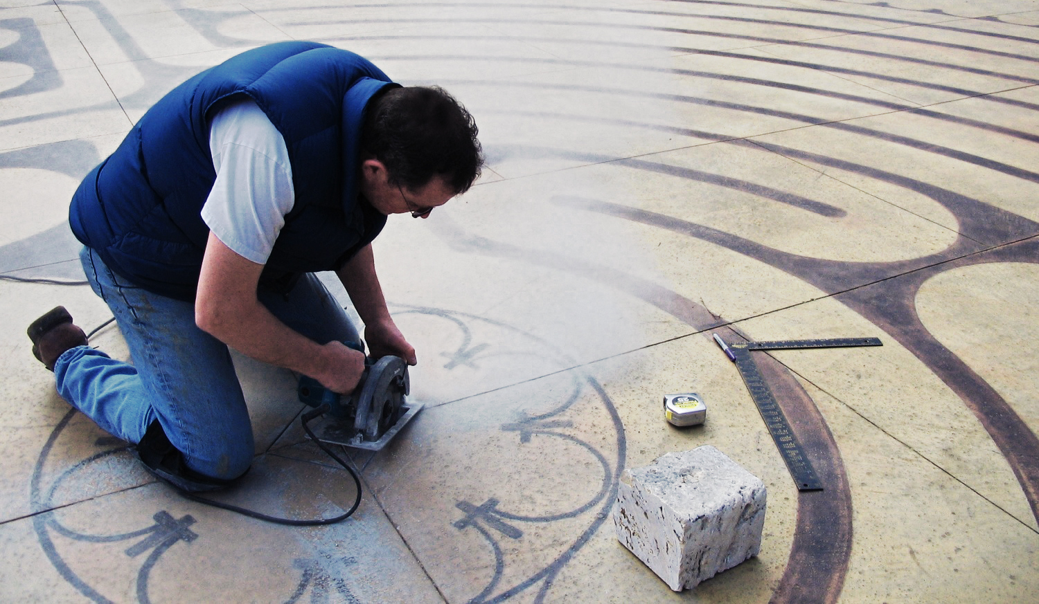 Setting the center stone at the MPBC labyrinth. The stone is from the same quarry that furnished the stone for the labyrinth in Chartres, France.