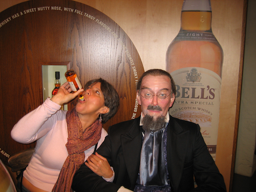 Pretending to drink scotch with a wax-man in Scotland.