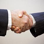 Handshake - 2 men  Photo by  Flazingo Photos  under  CC BY-SA 2.0