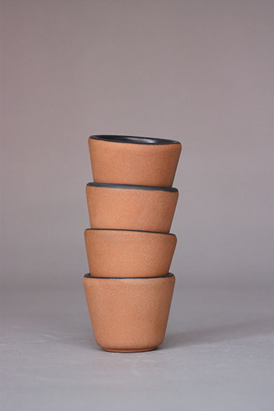 Black Glazed Clay Shot      Glasses (set of 4)     Ceramics     WholeSale Avail. for MEX, USA, JAP     Buy @   Amazon.com   ,   Amazon.com.mx    Mezcal is a traditional drink that is part of the ritual and ceremonial life of many indigenous cultures. It has never lost its spiritual characteristic, just the meaning is different, nowadays it is considered a drink that helps to create bonding.  メスカルはメキシコの伝統的なお酒で多くの部族の間で儀式などで飲まれてきました。その霊的な印象はいまも失われておらず、飲むと親しくなるお酒として親しまれています。そんなメスカルを数人で楽しむための4個セットのカップです。