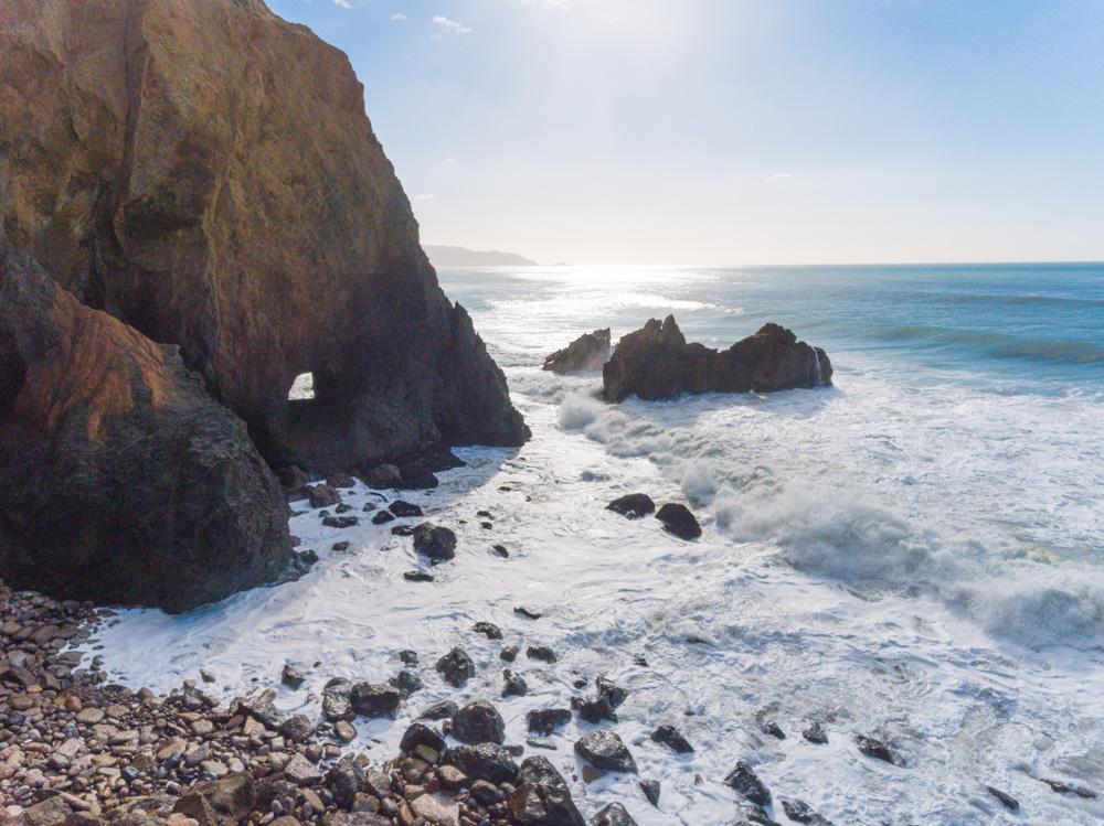 Tobin Tunnel (hole in rock) and Surf. Mussel Rock. 2016. DJI Phantom 4 Drone.