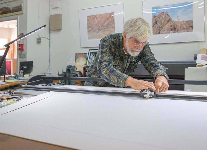 Cutting a 50 inch matt for the  Life Form exhibit.