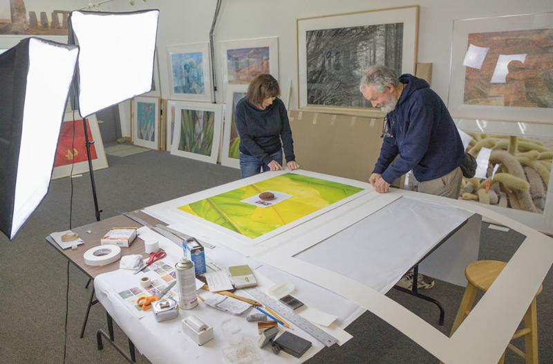 Friends Eleanor Normille and Carl Schwab assembling a matt.