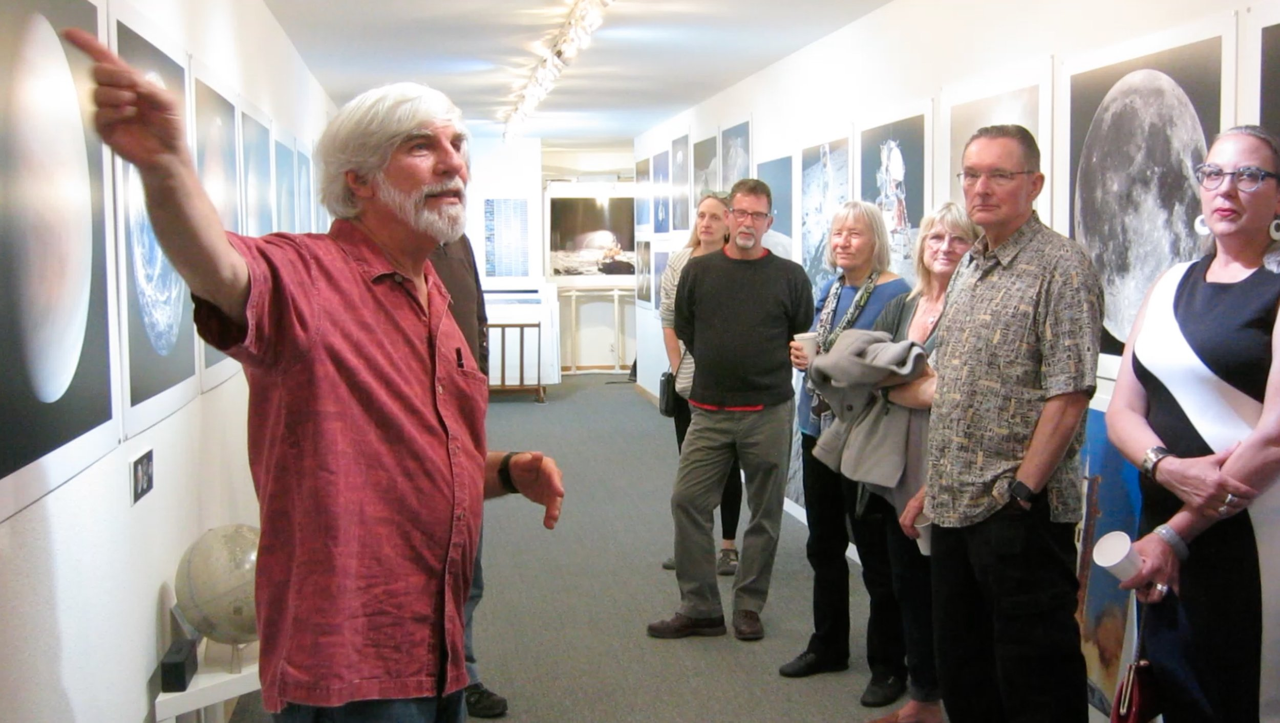 Steve presenting the 50 Years of Space Photography Exhibit. Landing Party. Stephen Johnson Photography. Pacifica Center for the Arts. July 20, 2019. from video frame by Fiona McDonnell.