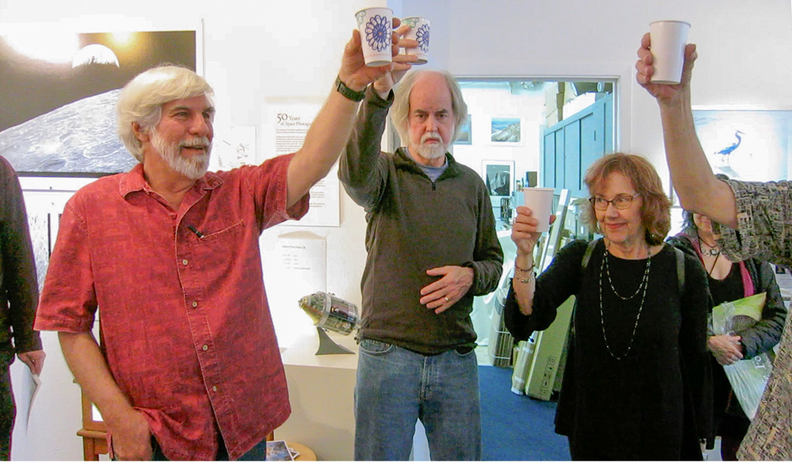 Toasting the First Step on the Moon -50 with Dennis Wingo and Morning Nichols. Landing Party. Stephen Johnson Photography. Pacifica Center for the Arts. July 20, 2019. from video frame by Fiona McDonnell..