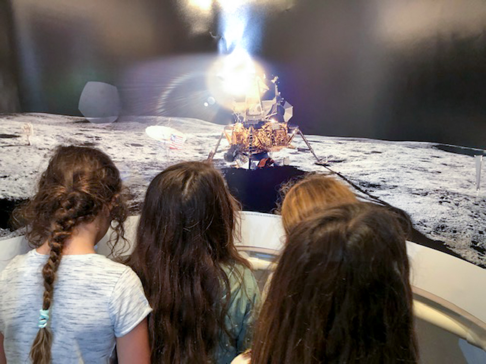 In front of the Apollo 14 Panoramic, 3rd. Graders from Ocean Shore School in Pacifica visiting the Space Exhibit. 2019. Photo by Sheila Gamble.