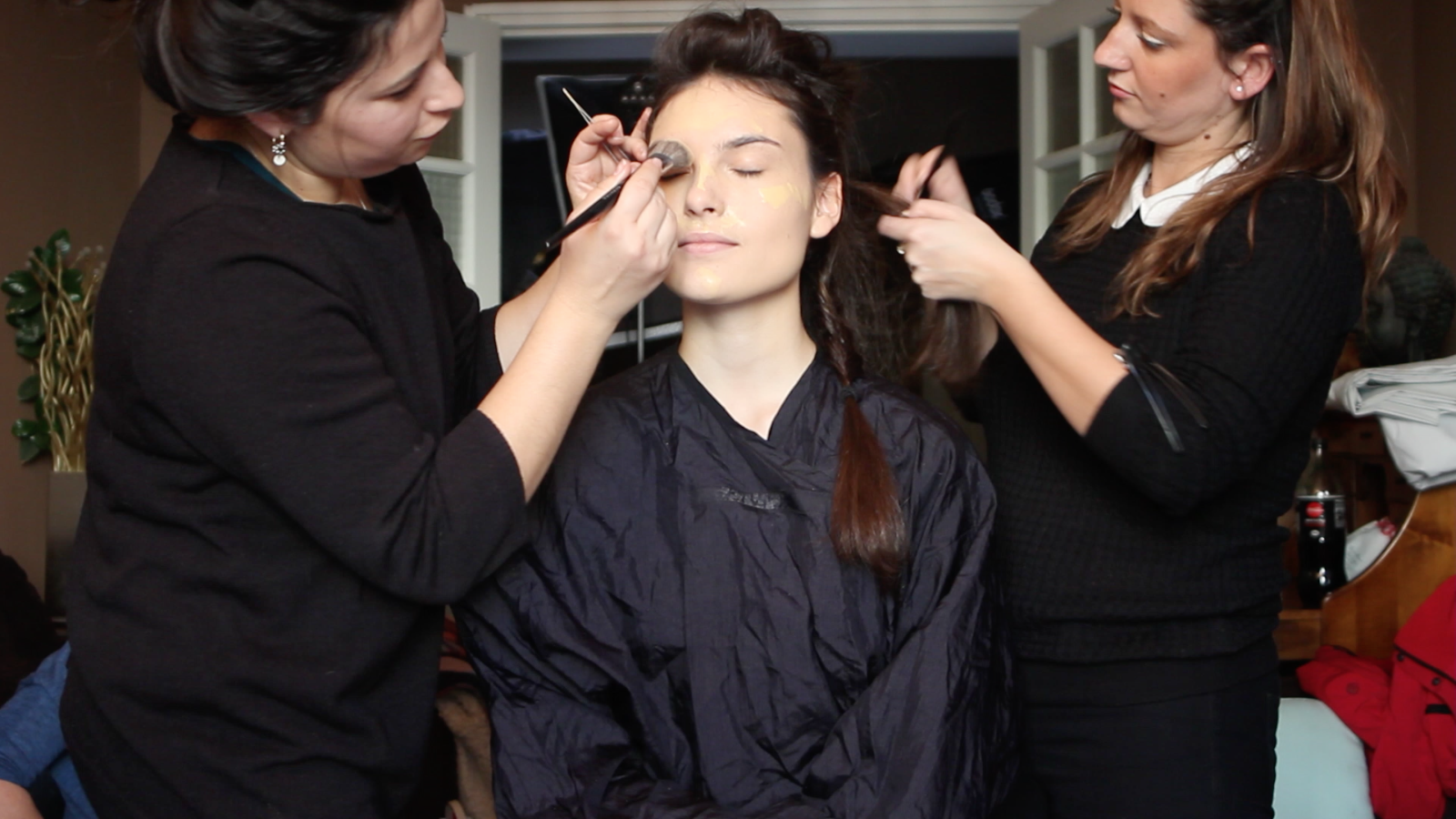 model getting pampered with hair and makeup