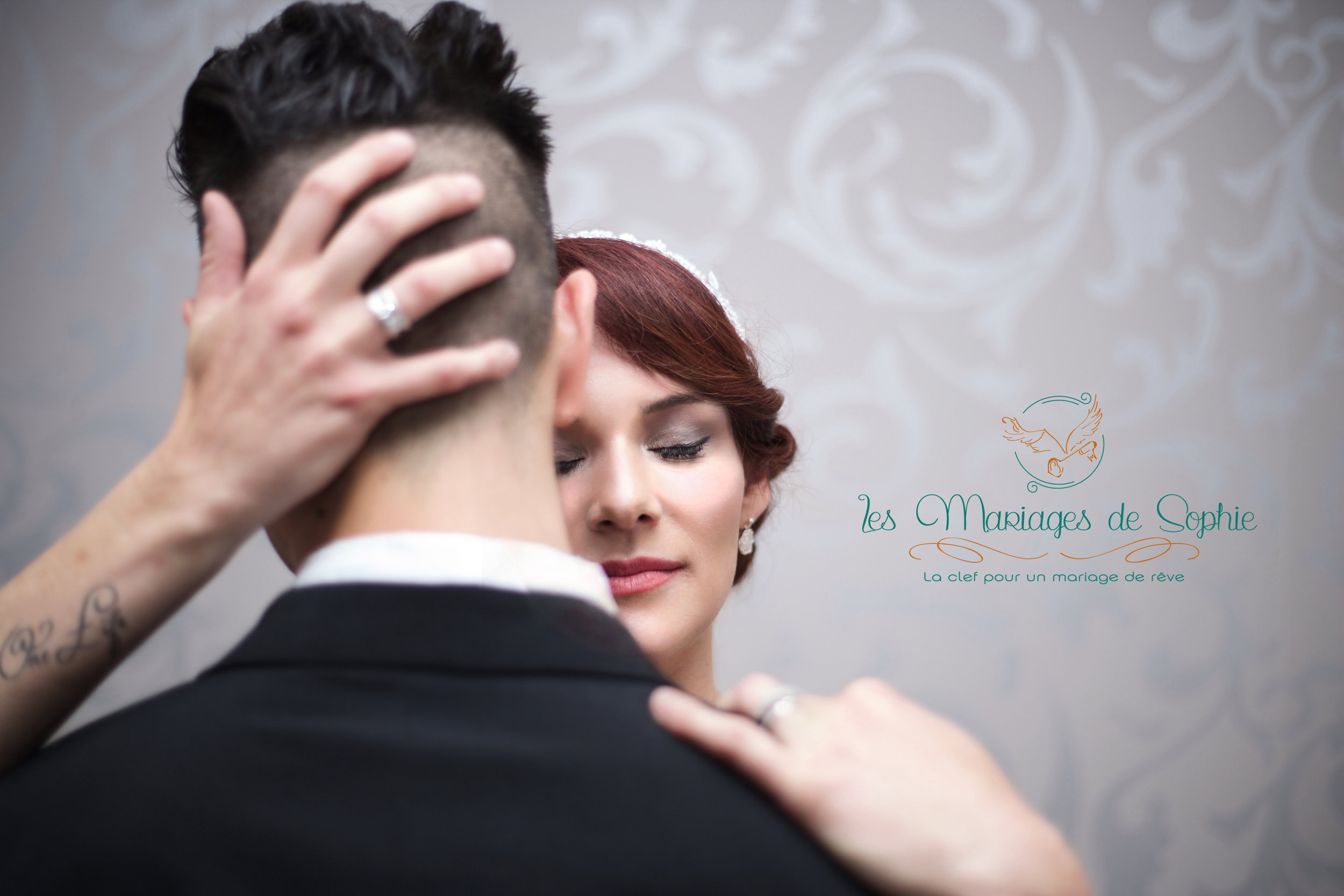 Couple embrace with sophie logo.jpg