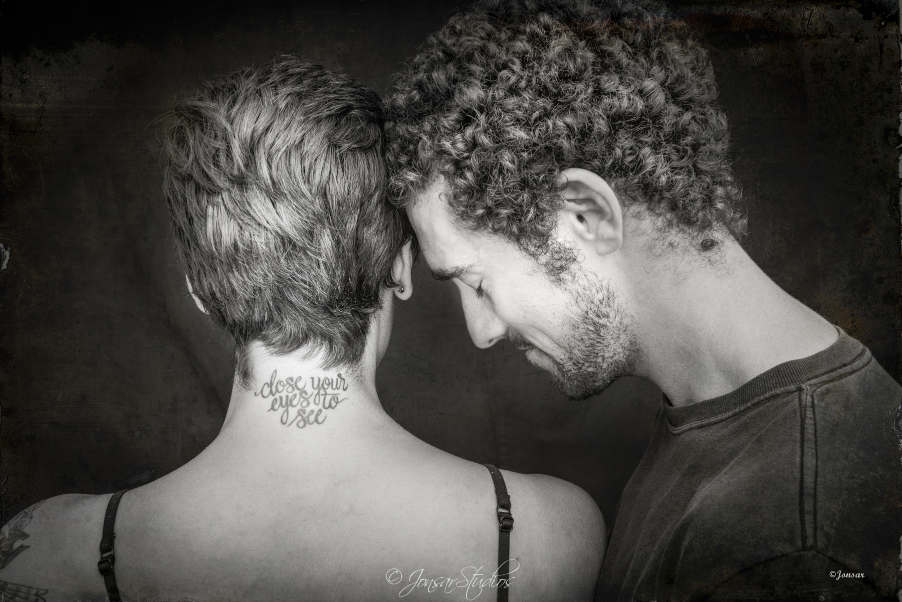 Portrait of man and woman in quiet connection, Close Your Eyes to See Tattoo