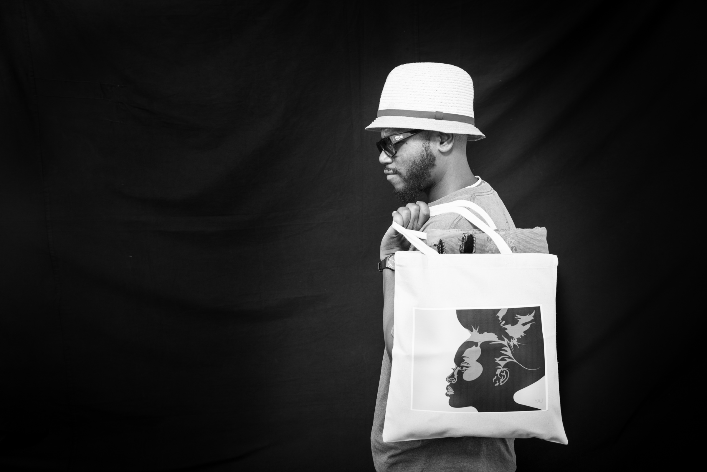 Man with Canvas Bag photographed on black background