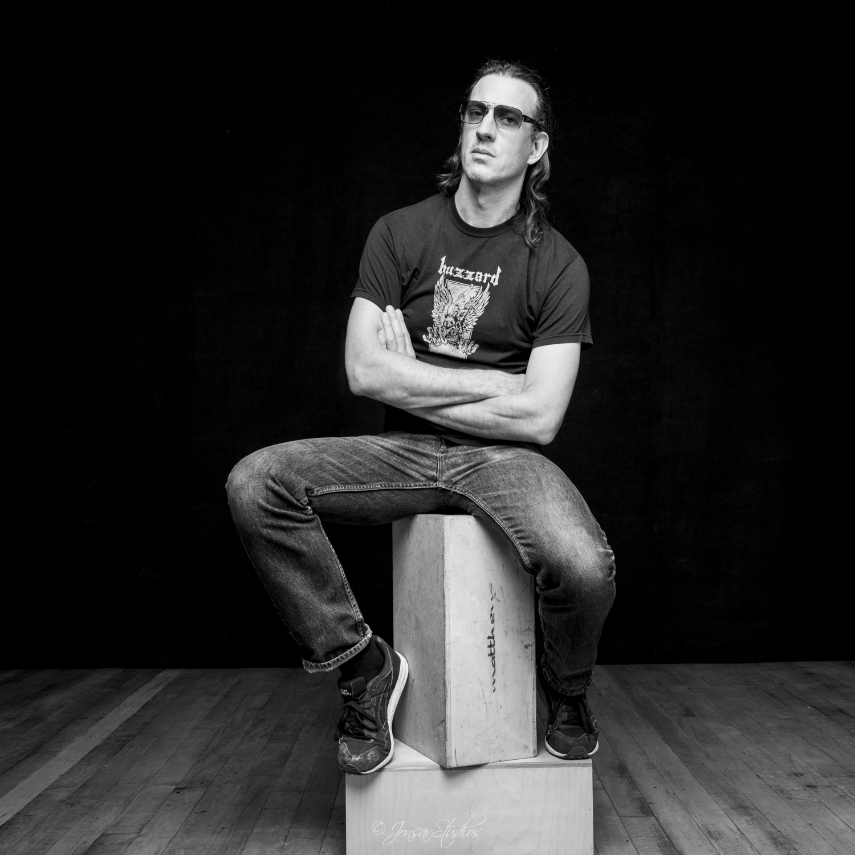 Portrait of man sitting on apple boxes