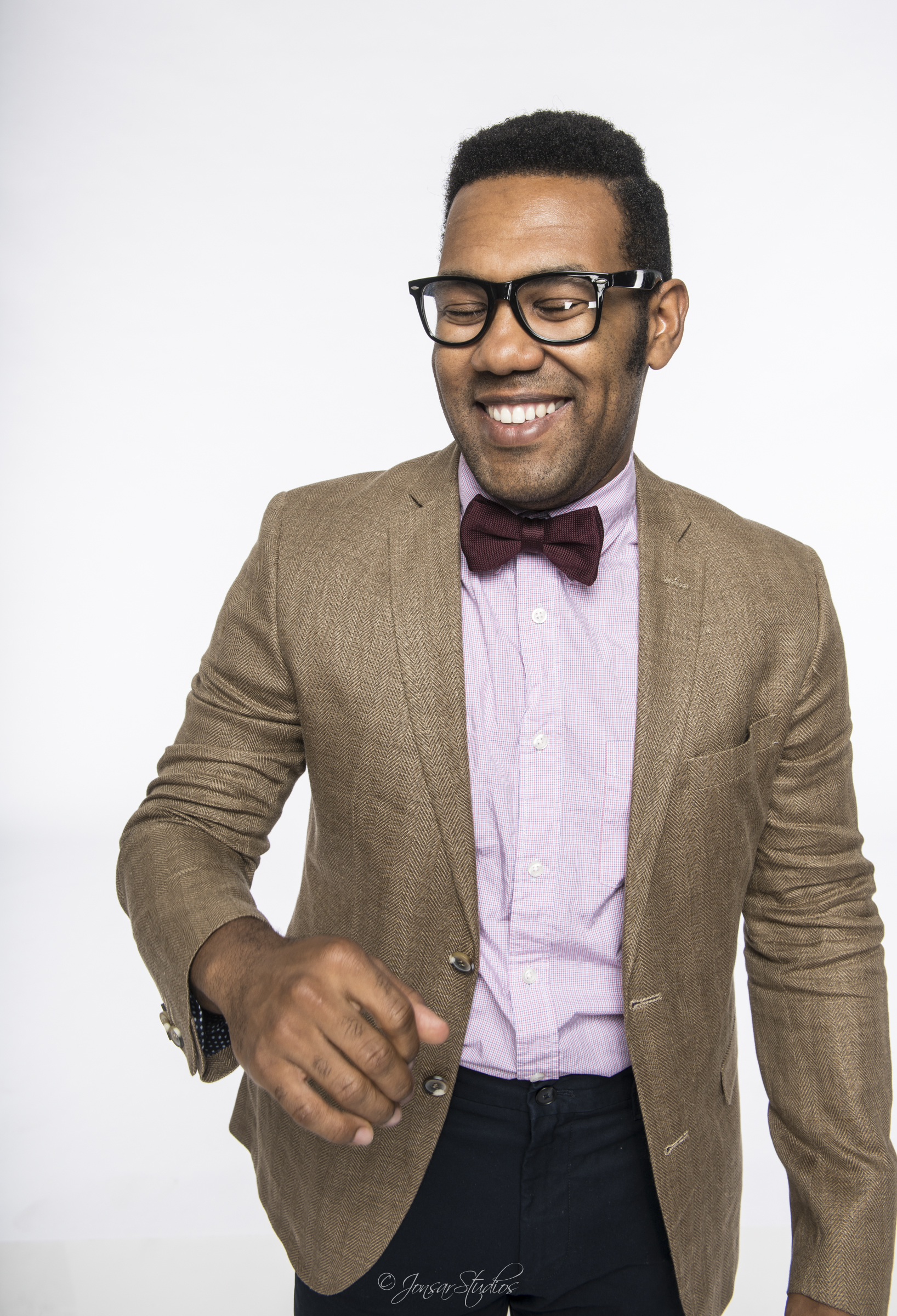 Laughing actor in bow tie
