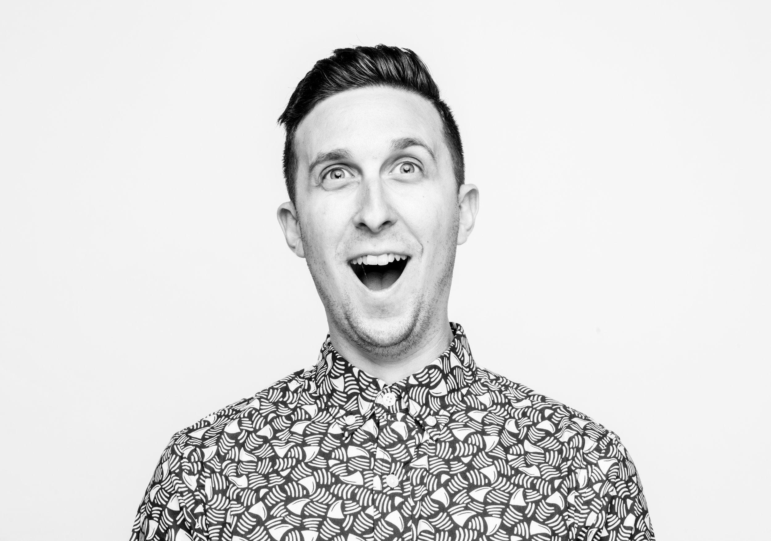 Ecstatic smile of man on white background