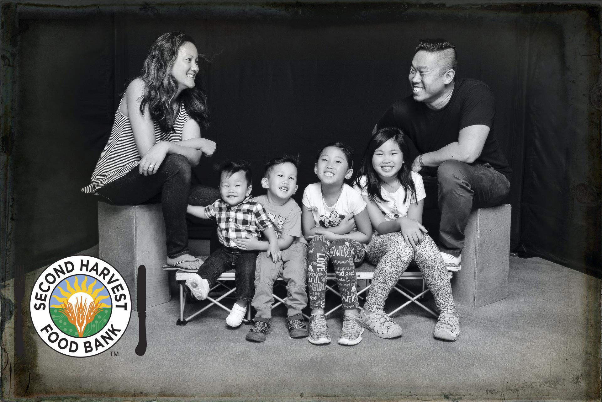 Black and White Family Portrait on Black Background