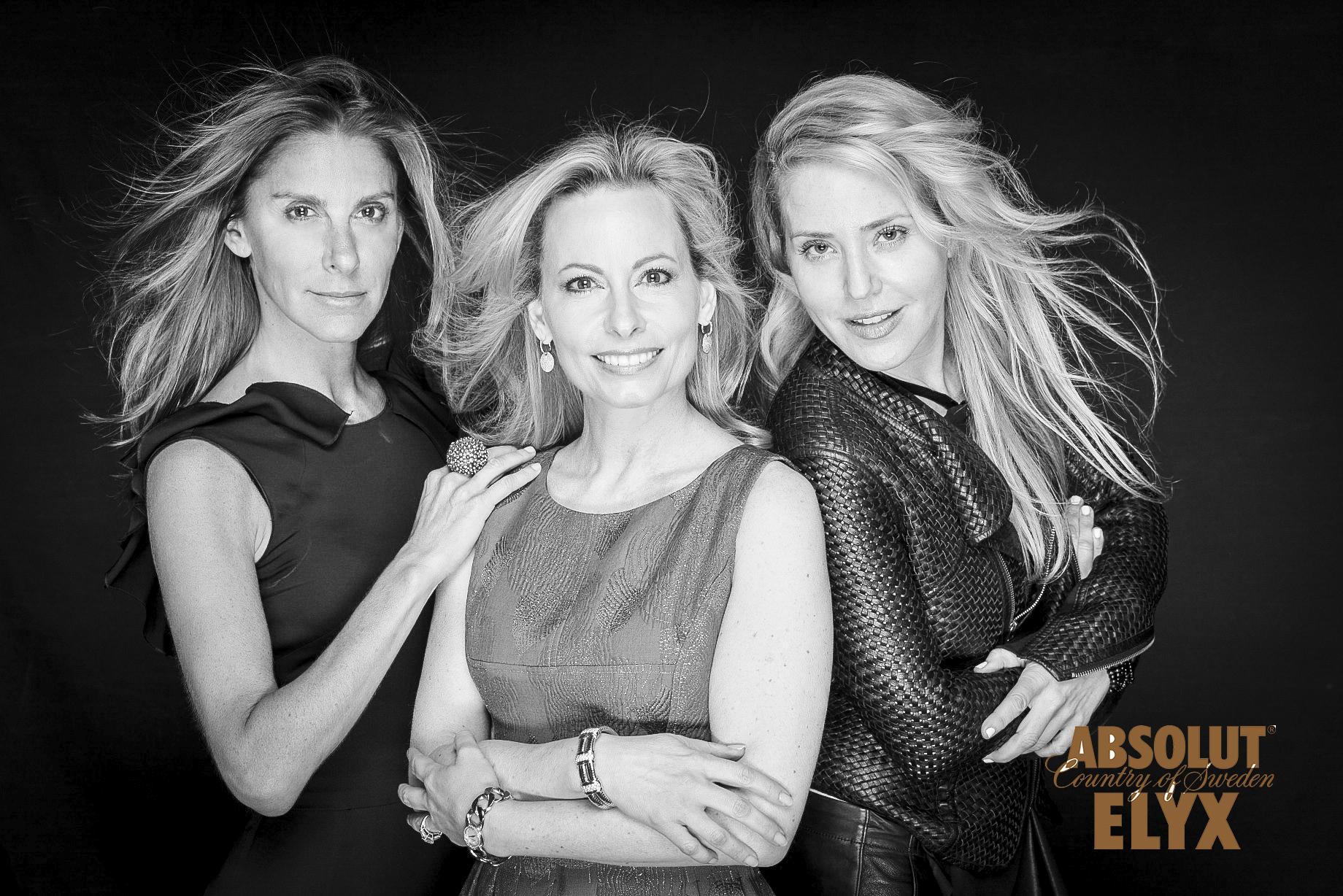 Black and White Portrait of Three Blonde Women on Black Background